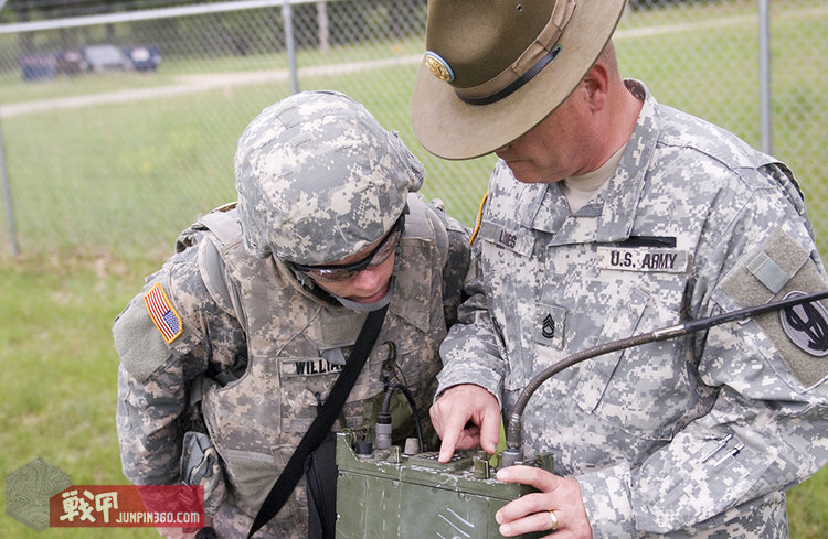 U.S._Army_Sgt_1st_Class_Dale_Lines,_right,_drill_sergeant,_95th_Training_Division,_points_out_a_deficiency_on_a_radio_to_Spc._Russell_Williams,_108th_Training_Command,_during_the_2013_Army_Reserve_Best_Warrior_130625-A-EZ357-958.jpg