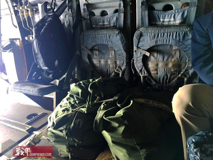 Built for utility, the interior of the MV-22B is bare bones. Unused seats are folded up against the wall of the aircraft and cargo is tied to the floor.