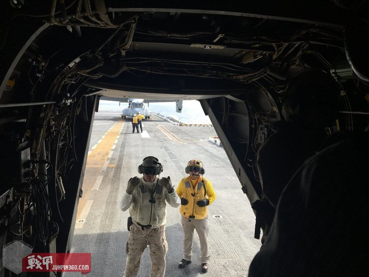 Within a few seconds, personnel appeared at the back hatch of the MV-22B and directed us to walk in single file as he escorted us around the flight deck.