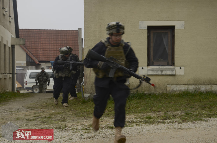 U.S._Soldiers_with_the_1st_Battalion,_4th_Infantry_Regiment,_operating_as_opposing_forces,_cross_an_alleyway_during_a_decisive_action_training_environment_exerciseat_the_Joint_Multinational_Readiness_Center_.jpg