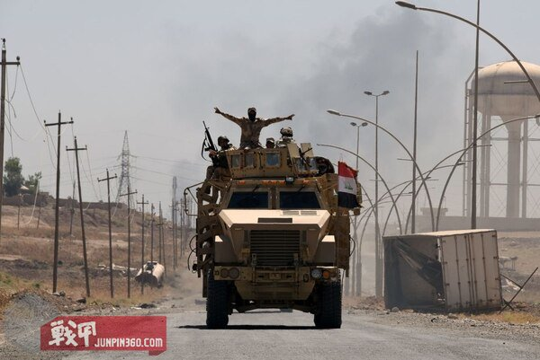 Iraqi government forces drive on a road leading to Tal Afar on June 9, 2017, during ongoing battles to retake the city from Islamic State fighters. (Mohamed El-Shahed/AFP/Getty Images)