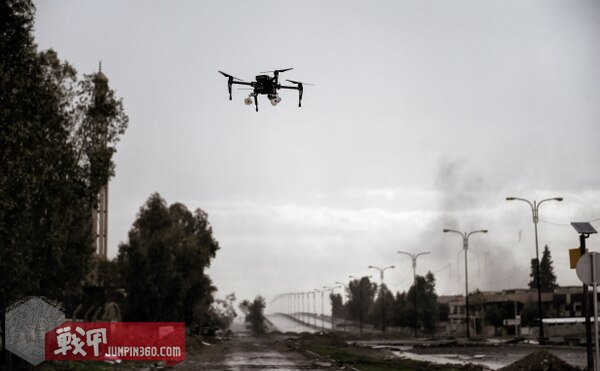 A picture taken on March 14, 2017, in the northern Iraqi city of Mosul shows a drone carrying two grenades flying in a test flight by Iraqi forces which aim to use it against Islamic State fighters. (Aris Messinis/AFP/Getty Images)